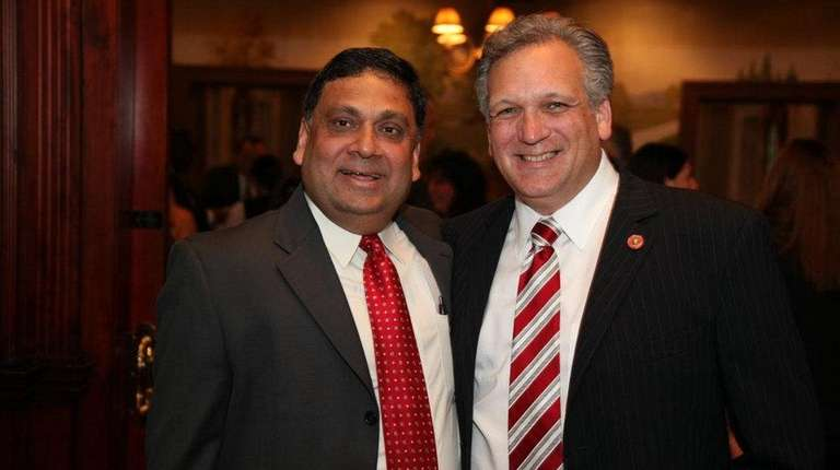 Harendra Singh, left, with former Nassau County Executive