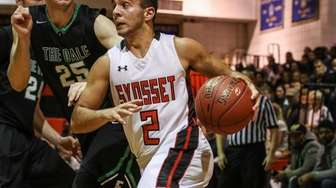 Michael Stanco of Syosset drives to the basket