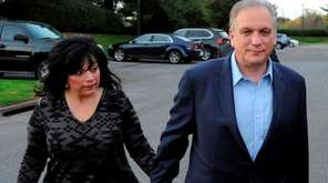 Edward Mangano and his wife, Linda, arrive at