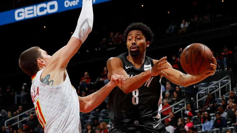 Spencer Dinwiddie of the Nets looks to pass