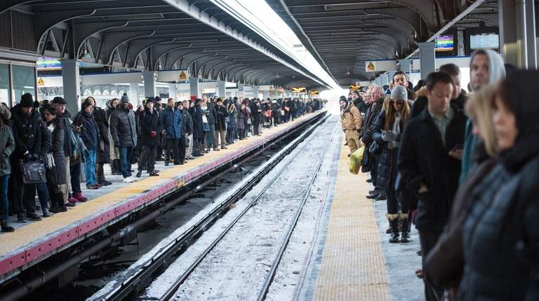 Commuters wait on both platforms for a westbound