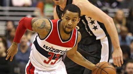 Trey Burke of the Wizards dribbles up the