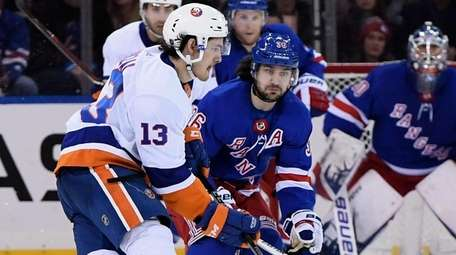 New York Islanders center Mathew Barzal skates with