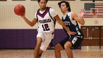 Kamaal Chin of Sewanhaka drives to the basket