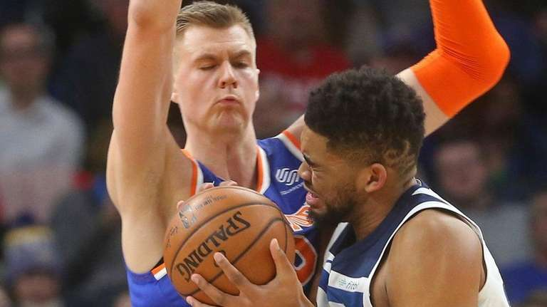 The Timberwolves' Karl-Anthony Towns, right, tries to get