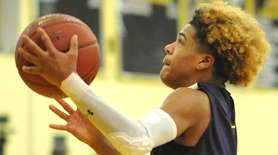 Ty-Shon Pannell of Central Islip drives to the