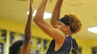 Darryan Fuentes of Central Islip, right, drives to