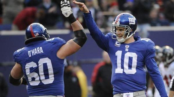 New York Giants quarterback Eli Manning celebrates with