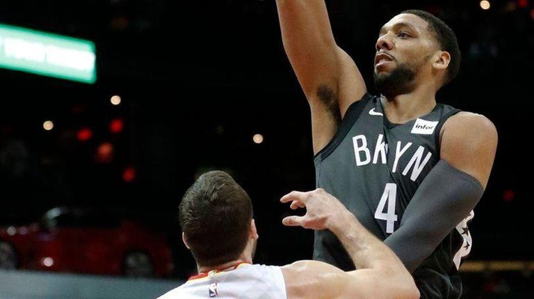 Nets center Jahlil Okafor shoots over Hawks center