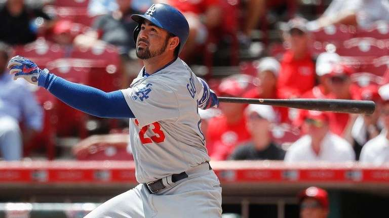 The Dodgers Adrian Gonzalez hits a solo home