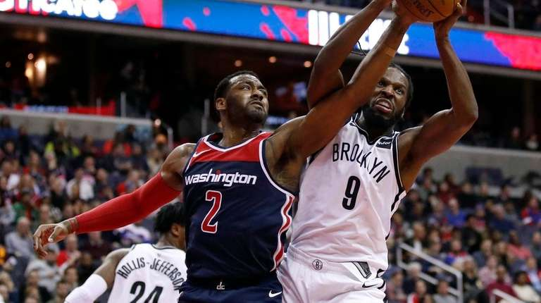 Wizards guard John Wall and Nets forward DeMarre