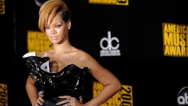 Artist Rihanna arrives at the 37th Annual American