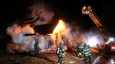 Firefighters on the scene of a fire at