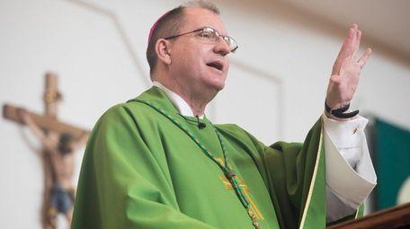 Bishop John Barres speaks during a Mass in