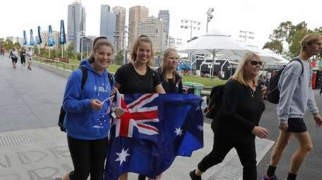 Spectators make their way into Melbourne Park to