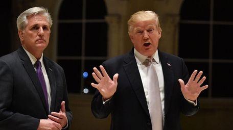 President Donald Trump, right, speaks beside House Majority