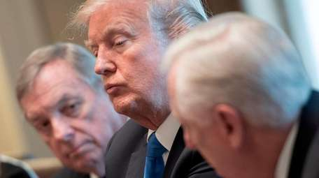 President Donald Trump, with Sen. Dick Durbin, left,