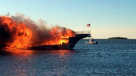 Flames engulf a boat Sunday, Jan. 14, 2018,