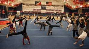 Gymnasts do cartwheels at the Cartwheels for a