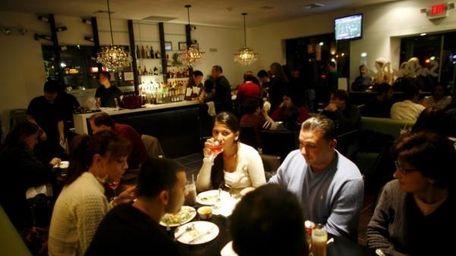 Diners enjoy Thai food at SriPraPhai Restaurant in