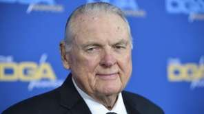 Keith Jackson, whose signature phrases like