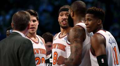 Knicks coach Jeff Hornacek speaks with his team