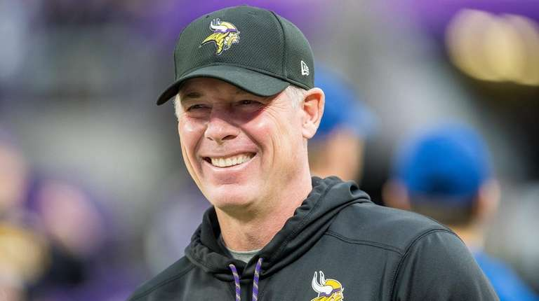 Vikings offensive coordinator Pat Shurmur smiles before an