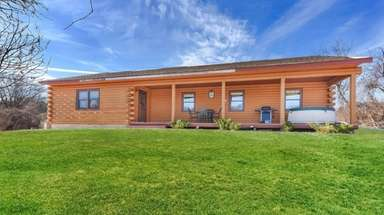 This log cabin in Montauk has four bedrooms