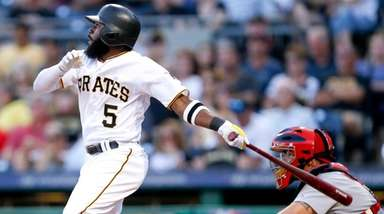 Pirates' Josh Harrison watches flight of home run