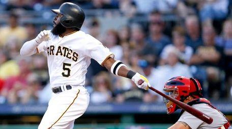 Pirates' Josh Harrison watches flight of home run