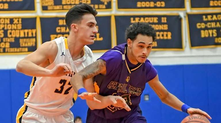 Central Islip's Angel Jimenez drives past Northport's Daeshron