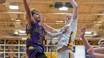 Central Islip's Ty-shon Pannell goes for the layup
