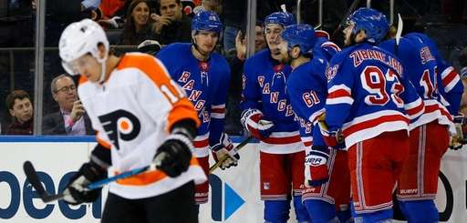 Rick Nash of the Rangers celebrates his first-period