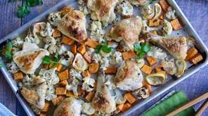 Assorted chicken pieces are roasted with cauliflower, sweet