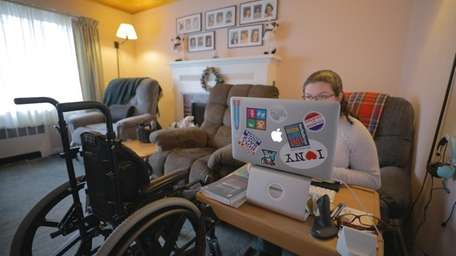 Disability advocate Emily Ladau, 26, in her West
