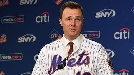 The Mets re-introduce outfielder Jay Bruce, who signed