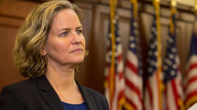 Nassau County Executive Laura Curran signs an executive