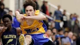 East Meadow's Anthony Squiciarin wins the 55-meter high