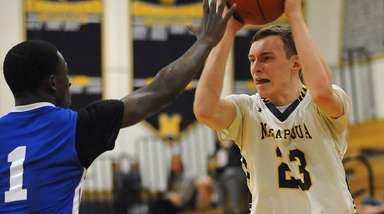 Kevin Voigt of Massapequa, right, gets pressured by