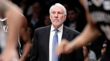 Spurs head coach Gregg Popovich watches his team