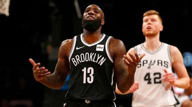 Quincy Acy of the Nets reacts during the
