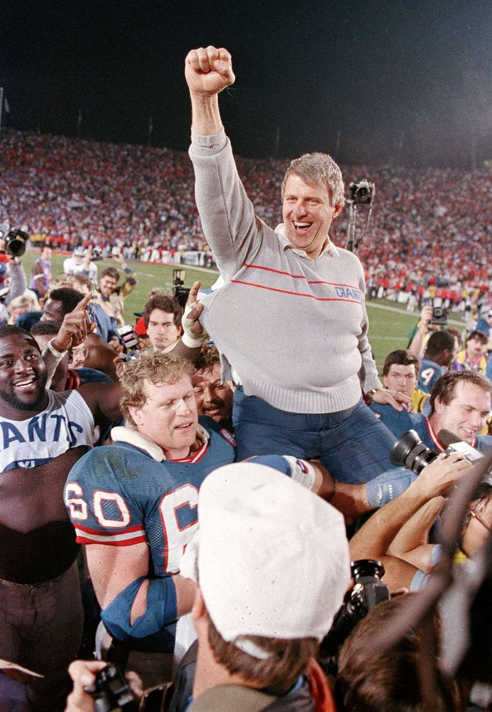 New York Giants coach Bill Parcells is carried