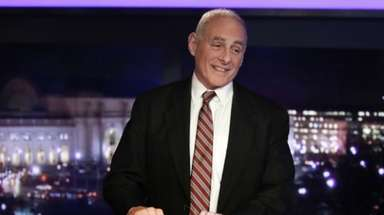 White House chief of staff John Kelly stands