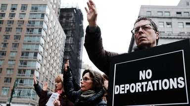 Immigration activists, clergy members and others protest last