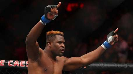 Francis Ngannou celebrates his victory over Alistair Overeem