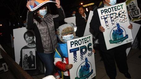 Hiroshi Sandoval, 5, of Westbury, center, joined activists