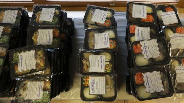 Frozen meals are bagged by volunteers for delivery.