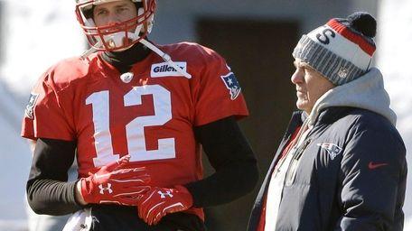 New England Patriots quarterback Tom Brady has gloves