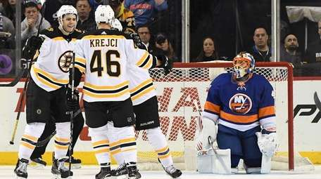 Islanders goaltender Jaroslav Halak looks on after Bruins