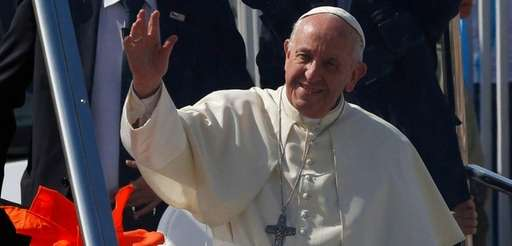 Pope Francis arrives to celebrate Mass on Lobito